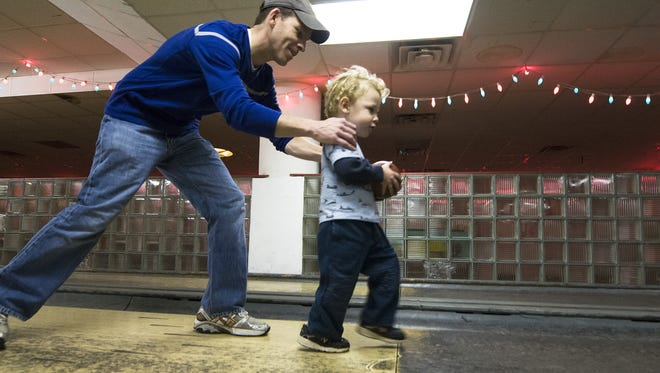 Matt Ritchey and his son Hudson, then 2, enjoyed Action and Atomic Duckpin Bowling in 2012.