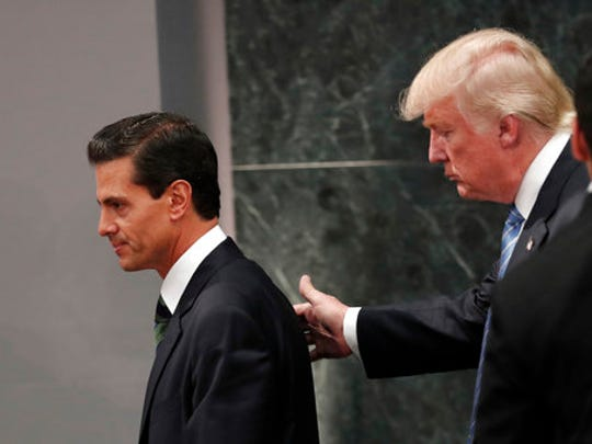 FILE - In this Aug. 31, 2016 file photo, Republican presidential nominee Donald Trump walks with Mexico President Enrique Pena Nieto at the end of their joint statement at Los Pinos, the presidential official residence, in Mexico City. Like the rest of the world, Mexico only learned through media reports on Wednesday, April 26, 2017 that the Donald Trump Administration was considering a draft executive order to withdraw the United States from the North American Free Trade Agreement.