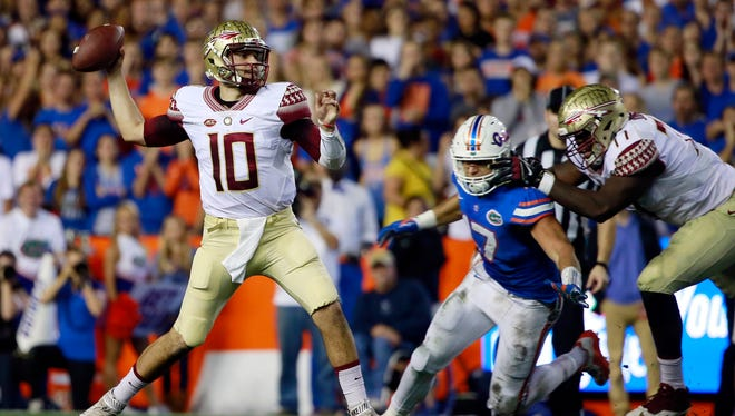 Florida State quarterback Sean Maguire looks for an open man downfield in the Seminoles' lopsided win Saturday at Florida.