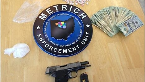 MARMET detectives seized a .45 caliber handgun, heroin, pills and cash Monday.