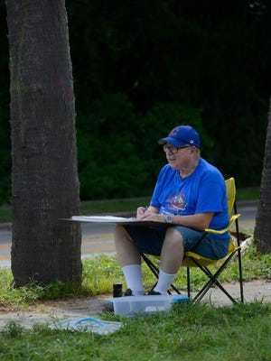 Dorssie Melvin does a  sketch near the 17th Ave. trestle Sunday during the Pensacola Urban Sketching meeting.