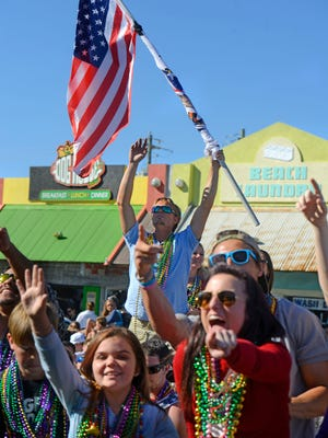 Revelers shout for beads during the 2017 Krewe of Wrecks Mardi Gras Parade at Pensacola Beach. This year's parade will be Sunday.