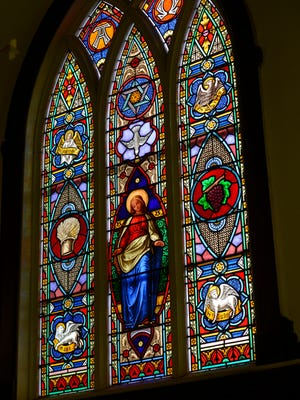A stained glass window that children in the 1880s raised money to purchase is seen at St. Mary's Episcopal Church in Milton on Sunday, July 16, 2017. The church will mark its 150th anniversary next month.