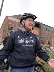 Michigan Gov. Rick Snyder in front of the historic Globe Trading Co. building