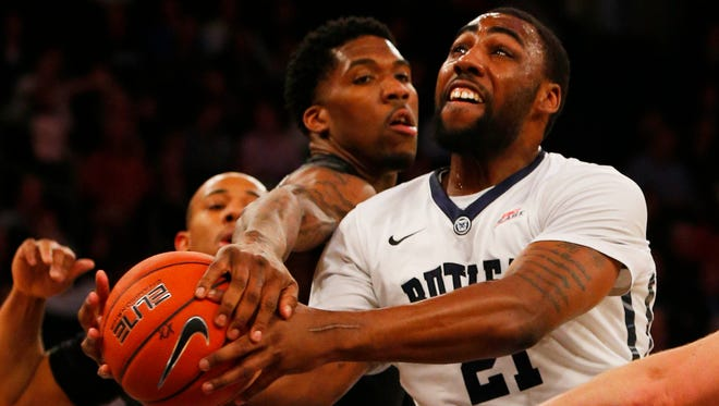 Xavier guard Remy Abell (10) defends against Butler forward Roosevelt Jones (21) during first half of quarterfinal game at Madison Square Garden.