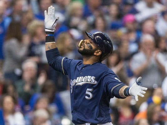 Milwaukee Brewers' Jonathan Villar crosses home after hitting a solo home run off Chicago Cubs' Kyle Hendricks during the first inning of a baseball game Saturday, April 8, 2017, in Milwaukee. (AP Photo/Tom Lynn)