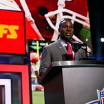 Former NFL player Tony Richardson announces that the Kansas City Chiefs selects Mississippi State's Chris Jones as the 37th pick in the second round of the 2016 NFL football draft, Friday, April 29, 2016, in Chicago.