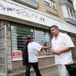 Wafik Altaweel gets a pat on the back from a neighbor outside his store, Old World Meat Market, on North Clinton Avenue. The store used to be Hartmann's meat market.