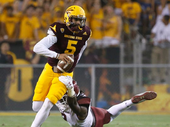ASU's Manny Wilkins (5) breaks away from New Mexico