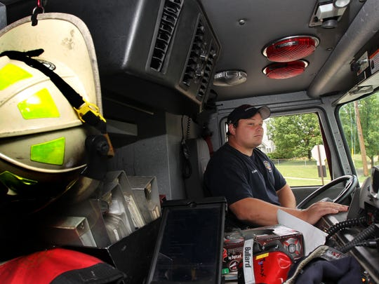 Covington firefighter Ben Cawood backs a fire truck