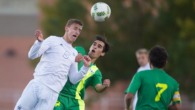Matthew Khouri of Fort Collins and Taylor Trujillo of Fossil Ridge High School try to gain control of the ball during a game at French Field Tuesday, October 4, 2016.