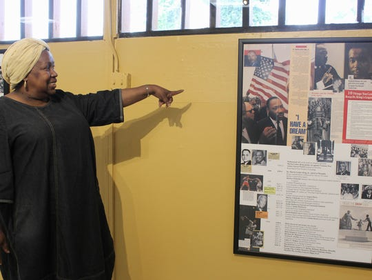 Jameelah El-Amin points to a timeline inside the Pamoja