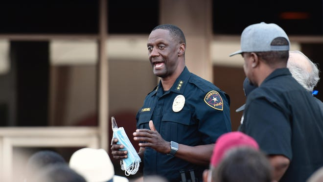 Lubbock Police Chief Floyd Mitchell talks to the crowd of hundreds of marchers during Monday evening's Silent Solidarity Walk hosted by the 100 Black Men of West Texas in downtown Lubbock.