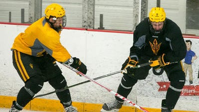 Joe Lappin, right, was one of eight players to score for ASU hockey Friday in a 9-2 win over Southern New Hampshire.
