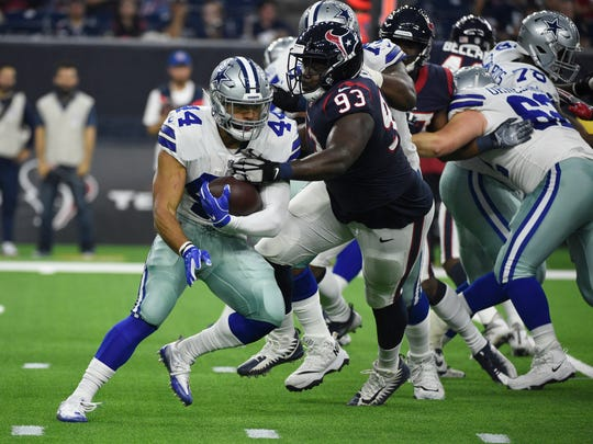 Dallas Cowboys running back Darius Jackson (44) is stopped by Houston Texans defensive end Joel Heath (93) during the first half of a preseason NFL football game Thursday, Aug. 30, 2018, in Houston. (AP Photo/Eric Christian Smith)