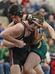 Pulaski's Levi Van Lanen battles Ashwaubenon's Sean Summers during their 195-pound match during Saturday's WIAA Division 1 wrestling sectionals at Green Bay West High School.