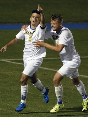 Delaware's Guillermo Delgado (left) celebrates his score with Jaime Martinez in the second half of the Blue Hens' 1-0 win in their season opener against Central Arkansas Friday at Grant Stadium.