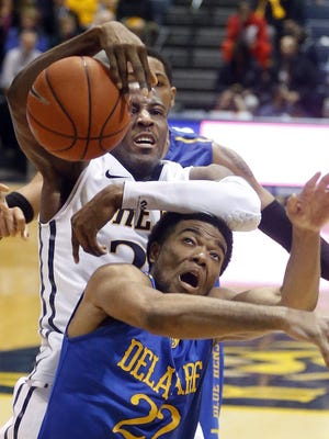 Drexel's Rodney Wiliams (top) battles for a rebound with Delaware's Cazmon Hayes in last season's UD-Drexel game in Philadelphia.