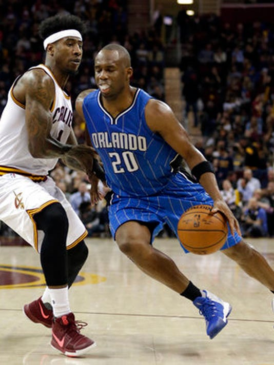 """FILE - In this April 4, 2017, file photo, Orlando Magic's Jodie Meeks (20) drives past Cleveland Cavaliers' Iman Shumpert (4) in the second half of an NBA basketball game in Cleveland. The agency that represents Meeks says the free-agent shooting guard has agreed to join the Washington Wizards. ASM Sports sent out a tweet on Sunday, July 2, 2017, saying Meeks """"has committed to signing"""" with the Wizards. (AP Photo/Tony Dejak, File)"""