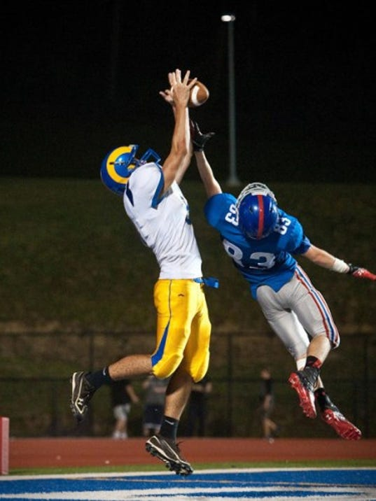Kennard-Dale's Danny Hall catches a touchdown pass over Spring Grove's Devin Fisher at Spring Grove on Friday. FOR GAMETIMEPA.COM -- JEFF LAUTENBERGER