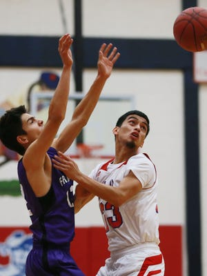 Franklin's Sam Ramirez, left, and Bel Air's Austin Jaquez chase after a loose ball Monday.