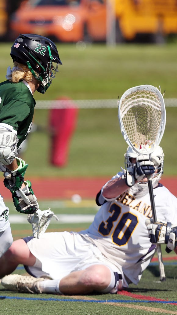 Pleasantville's Brian Reda (22) gets a shot by Highland