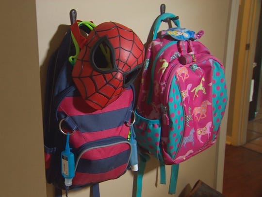 Jonathan McComb's children's backpacks sit undisturbed.