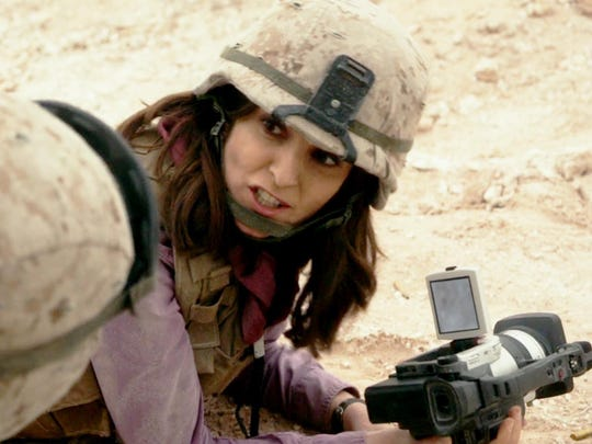 "Tina Fey stars as a TV reporter covering the war in Afghanistan in ""Whiskey Tango Foxtrot."""