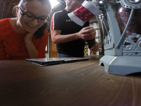 Asbury Park Press staffer Sarah Griesemer discovers clues at the Amazing Escape Room in Freehold.