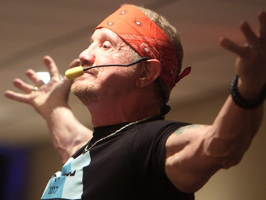 Former professional wrestler Dallas Diamond Page holds