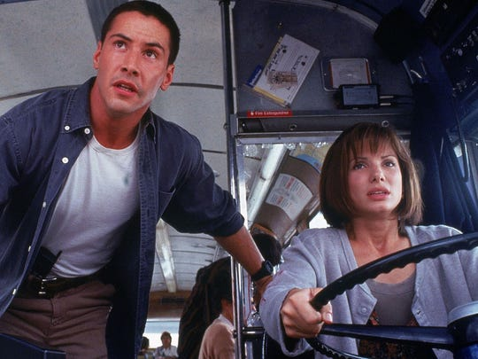 """Keanu Reeves and Sandra Bullock drive to stay alive in """"Speed."""""""