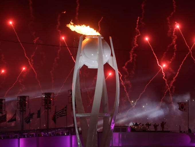 Fireworks explode over the Olympic Stadium during the