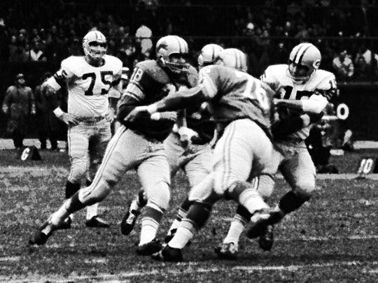 The Detroit Lions practically feasted on Green Bay quarterback Bart Starr, right, during their Thanksgiving game on Nov. 23, 1962. Sacks were not an official stat at the time, but NFL historians credit the Lions with 11 sacks in the game, including this one by Darris McCord and Roger Brown.