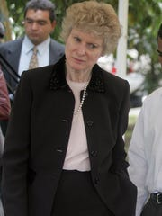 Former deputy assistant attorney general Mary Lee Warren speaks with a Colombian prosecutor in 2007. Warren wrote a letter in 1998, asking Sprint to turn over telephone records.
