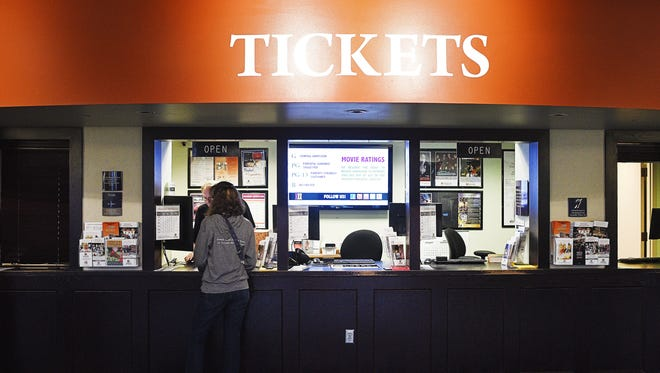 Sioux Falls' entertainment tax revenue fell slightly in the first quarter of 2016 compared to the same period in 2015. Natalie Acheson of Sioux Falls is shown buying tickets for the Kirby Science Discovery Center from Wes Skunberg, a box office representative Wednesday at the Washington Pavilion box office in Sioux Falls.