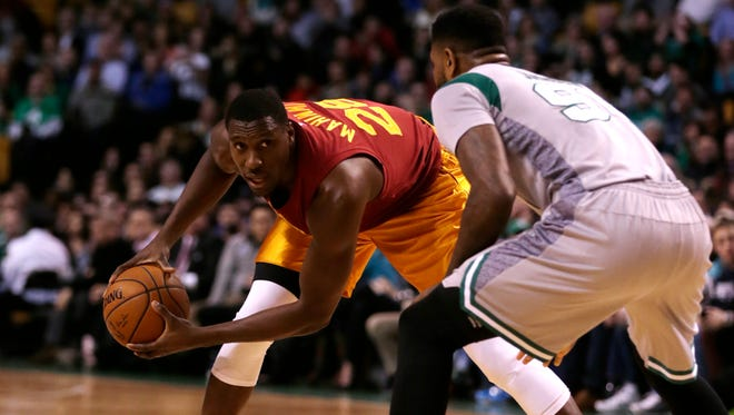 Indiana Pacers center Ian Mahinmi (28) brings the ball up court during the first quarter of an NBA basketball game in Boston, Wednesday, Jan. 13, 2016. (AP Photo/Charles Krupa)