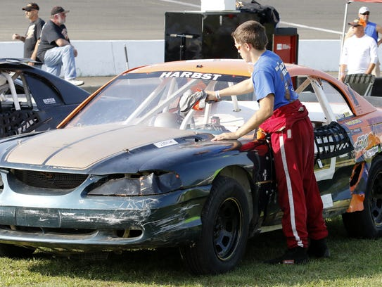 Tyler Harbst, 19, of Sayre wipes down his car Aug.