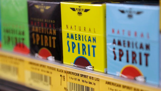 FILE - In this July 15, 2014, file photo, Natural American Spirit cigarettes are on display for sale, in Doral, Fla. Japan Tobacco is buying the non-U.S. assets of Reynolds American's Natural American Spirit for about $5 billion in cash, the companies announced, Tuesday, Sept. 29, 2015. The deal doesn't include rights to the Natural American Spirit brand name and associated trademarks in the U.S., U.S. duty-free locations, U.S. territories or in U.S. military outlets, all which will be kept by Reynolds American subsidiary Santa Fe Natural Tobacco Co. (AP Photo/Lynne Sladky, File) ORG XMIT: NYSB201