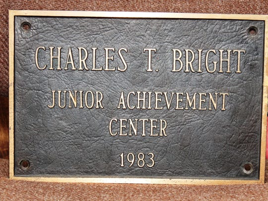 This plaque was once on the front of the Junior Achievment building. After the building was torn down, the plaque went to Charlie Bright.
