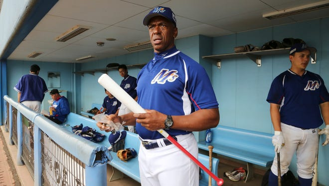 Ishikawa Million Stars player-manager Julio Franco, 56,  stands in the dugout before a game at a stadium in Konosu, north of Tokyo.   When Franco signed a contract with the Million Stars, Franco saw himself more as a manager than player but that hasn't been the case so far. Due to an injury to a key player, Franco finds himself playing more than he expected.
