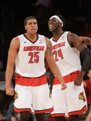 Louisville's Wayne Blackshear (25) and Montrezl Harrell (24) celebrate after Harrell scored during the first half of an NCAA college basketball game against Indiana, Tuesday, Dec. 9, 2014, in New York. (AP Photo/Frank Franklin II)