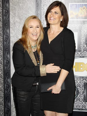 Singer Melissa Etheridge married Linda Wallem at San Ysidro Ranch on May 31, 2014 in Montecito, Calif. Melissa Etheridge (L) and Linda Wallem arrive at the Family Equality Council's Los Angeles Awards dinner held at The Globe Theatre on February 8, 2014 in Universal City, California.  (Photo by Michael Tran/FilmMagic) ORG XMIT: 466095245 ORIG FILE ID: 468019811