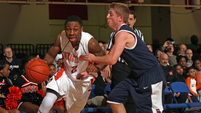 Spring Valley's Rickey McGill, left, dribbles past Ross Weinfeld of Byram Hills during the Class A boys basketball championship game at the County Center in White Plains on March 2. McGill was named Mr. Basketball for Section 1 by the Lower Hudson Basketball Coaches Association on Tuesday.