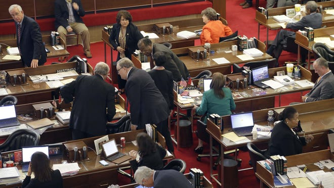 In this 2015 file photo, members of the North Carolina House conduct business at the General Assembly in Raleigh, N.C. (AP Photo/Gerry Broome)