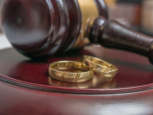 Golden rings and gavel in background.