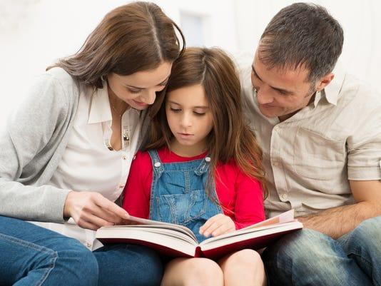 Parents Helping Daughter In Studies