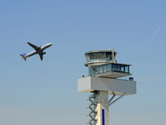 Airplane during take off and tower.