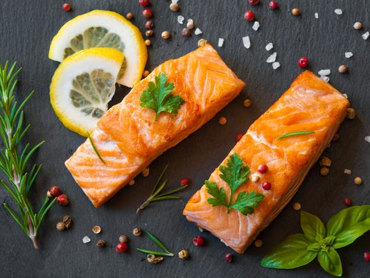 Salmon fish fillet with pepper and herbs