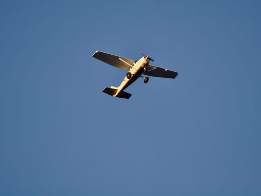 Cessna Airplane Flying Overhead in Bluesky