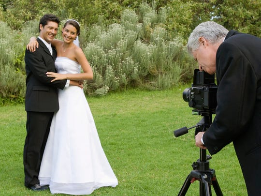 Do your homework to make sure you'll be comfortable with your wedding photographer.